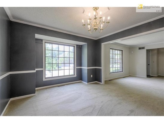 Formal dining room with tons of light and crown molding throughout (photo 3)