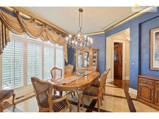 The formal dining room is ready for your next dinner party. (photo 4)