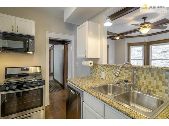 Granite counters with glass-tile back splash. (photo 5)