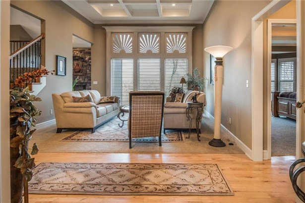 Step into elegance....notice the box beams in the ceiling.  Gorgeous plantation shutters.  Maple flooring. (photo 5)