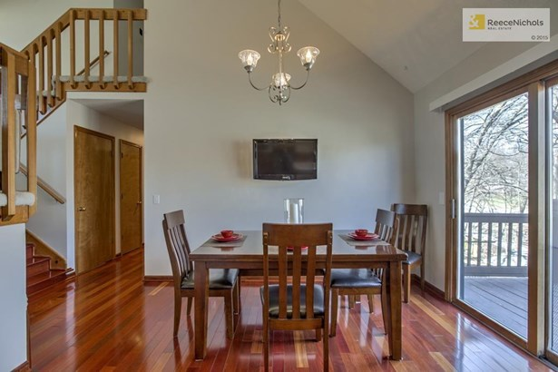 Newer Brazilian cherry wood floors in kitchen, dining area, hallway and stairs.  Large dining area with new light fixture. (photo 5)