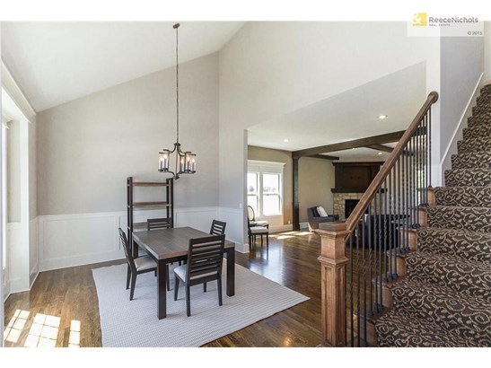 Hardwoods and tall ceilings throughout main level in this 2-story home. (photo 3)
