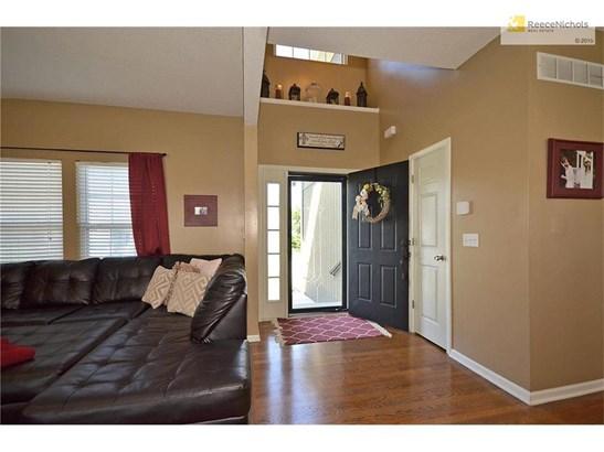 2 story entryway with hardwood floors. (photo 3)