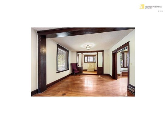 Grand entryway invites you in to original woodwork and hardwoods throughout (photo 2)