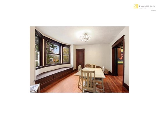 Huge formal dining room with window seat (photo 4)