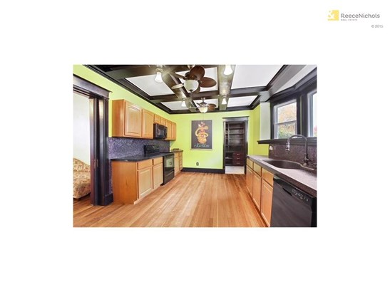 Enormous kitchen with newer appliances leads to pantry/mudroom and laundry room (photo 5)
