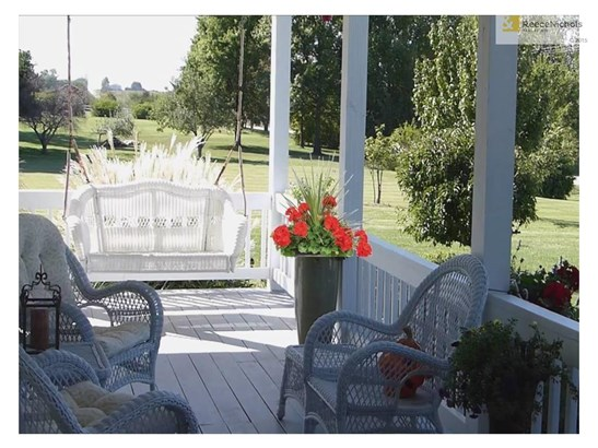Porch swing charm with heavenly views from the wrap around porch (photo 3)