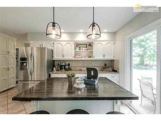 Completely updated kitchen with tons of space for entertaining and creating meals. Lovely pendant lighting and new doors lead out to your huge backyard. (photo 2)