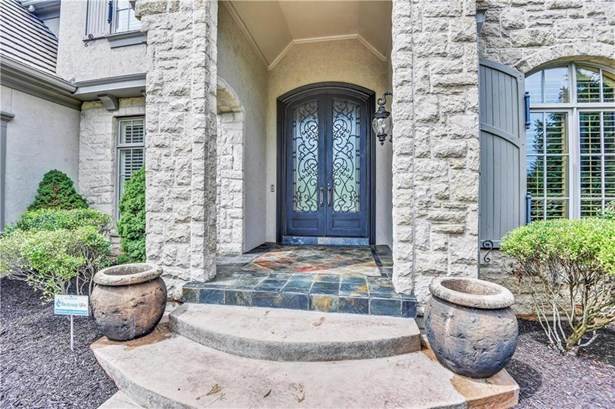 Lovely Stone Entry, Stamped Concrete walk way to entry door. Iron Entry Door, Slate at entry stoop. The inside is as impressive as the exterior.