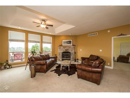 Main level family room with wood burning fireplace! Lots of windows for amazing view of property! (photo 3)