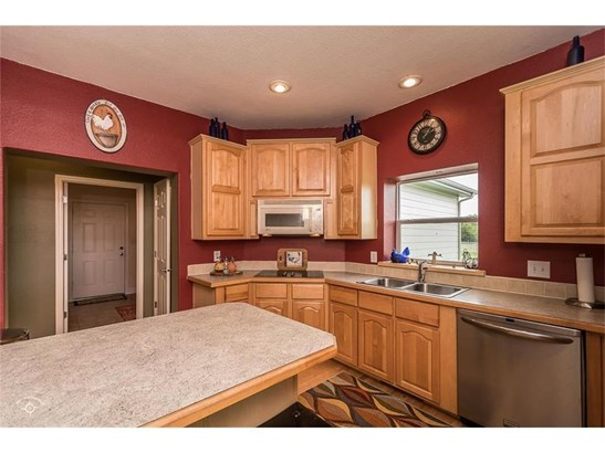 Kitchen is complete with lots of counter space and built in appliances. Hardwood flooring keeps space open and inviting. (photo 5)