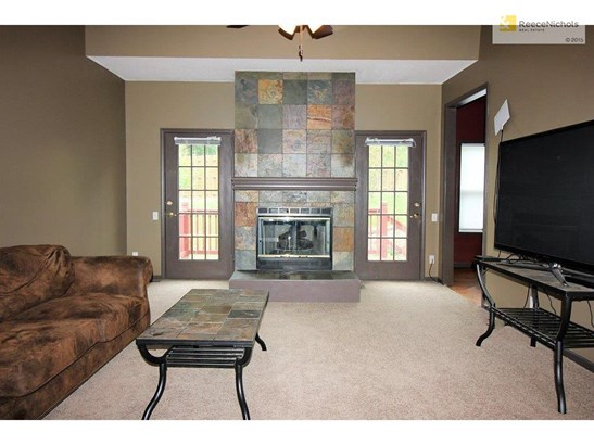Spacious living room with beautiful fireplace and access to the back deck. (photo 4)