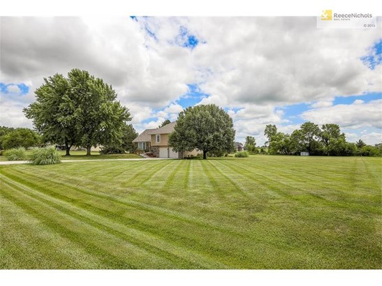 Home is nestled off the road on 2 acres. (photo 2)