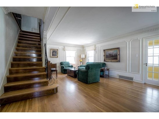 Formal spacious living room with door leading to private office space (photo 5)