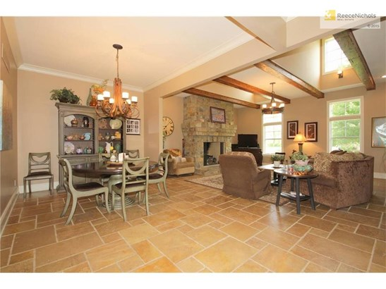 Open Dining to Great Room with natural stone tile flooring. (photo 5)