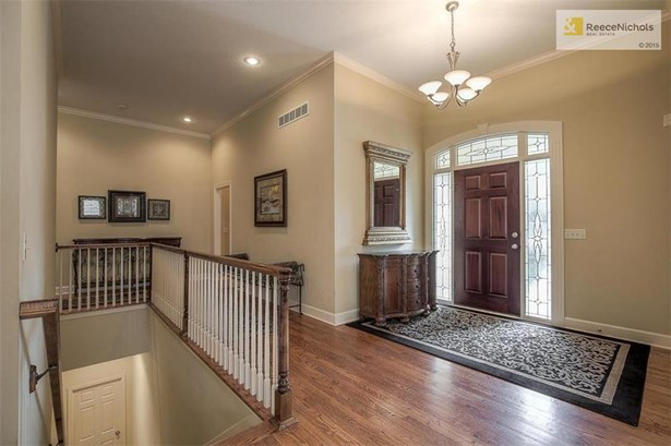 Very inviting spacious entry with gleaming hardwood floors throughout much of the first level and easy access to finished lower level. (photo 2)