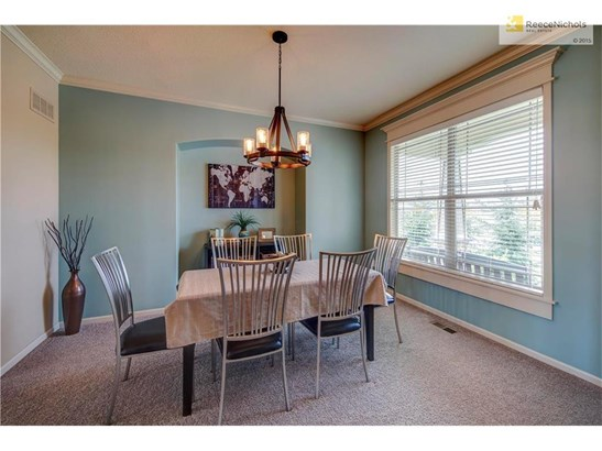 LOVELY FORMAL DINING AREA WITH  PLENTY OF SPACE FOR FAMILY GATHERINGS (photo 5)