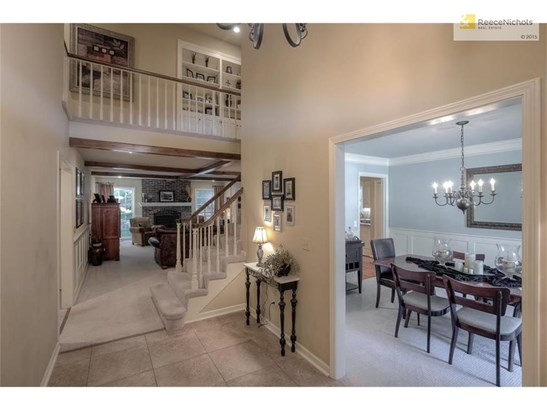 Formal dining room with gorgeous finishings & updated wainscotting! Entry leads to your spacious Great Room! (photo 5)