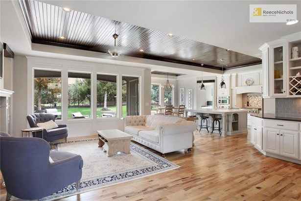 Open Hearth room/Kitchen/Breakfast Plan With Great Views Of The Backyard (photo 2)