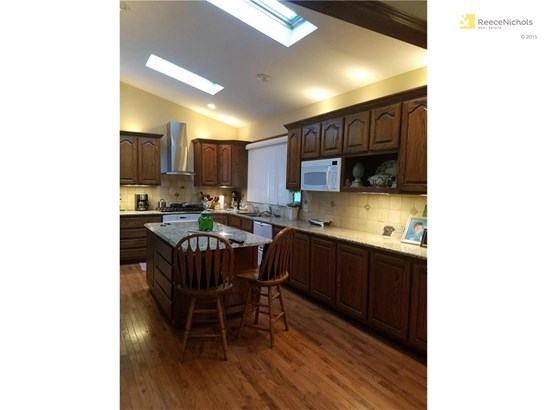 THIS IS A GOURMET KITCHEN!!! DBL DISHWASHER DRAWERS...TWO OVENS ONE CONFECTION ...BUILT IN HUGE FRIDGE....6 BURNER GAS STOVE..PASTA FAUCET (photo 4)