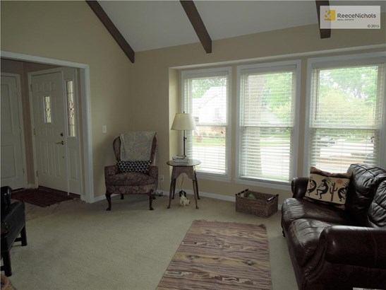 Another view of the living room. (photo 4)