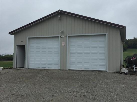 30X30 Metal building with electricity, concrete, and 2 garage door openers. (photo 2)