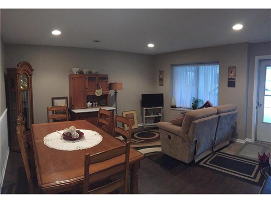 Family Room.  Door to the right goes to covered carport. (photo 5)