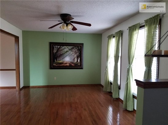 Formal living room adjoins formal dining with gorgeous hardwoods in both rooms... (photo 4)