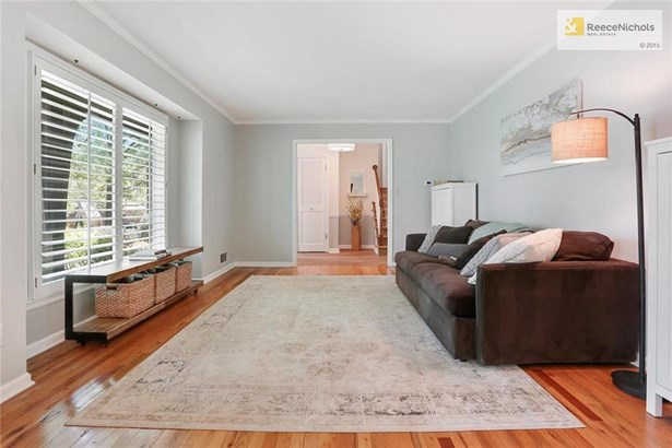 Beautiful living room with hardwood floors, plantation shutters, and amazing light (photo 2)