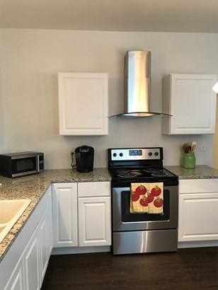 Kitchen with new stainless steel appliances. (photo 4)
