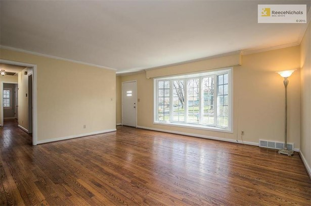 The spacious Living Room boasts gleaming hardwood floors, smooth ceilings and a large bay window. (photo 2)