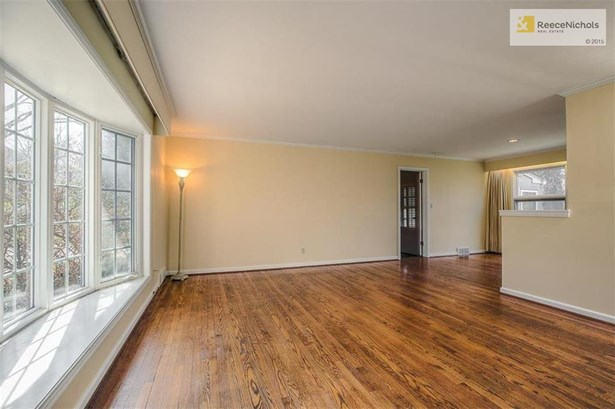 The beautiful Living Room with gleaming hardwood floors and a stunning bay window. (photo 3)