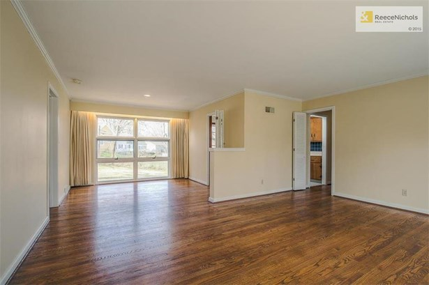 The Living Room opens up to the Dining Room that has a large window overlooking the backyard. (photo 4)
