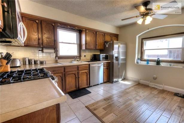 Kitchen features gas range (photo 5)
