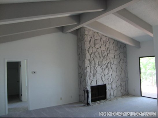 LR with vaulted ceilings  FP (photo 3)