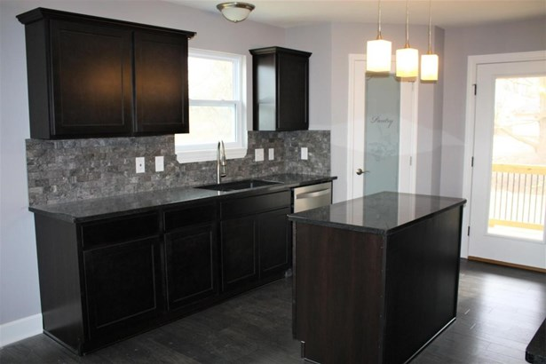 Great room from kitchen (photo 4)