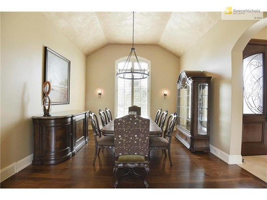 The formal dining room boasts fresh paint and updated chandelier. (photo 5)