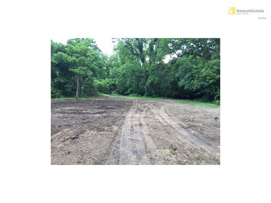 Level lot in heart of Shawnee is surrounded by trees on 3 sides.   You can have a home with a shop or outbuilding on this home site. (photo 1)