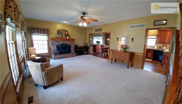 Large living room with wood burning fireplace and lots of windows! (photo 3)
