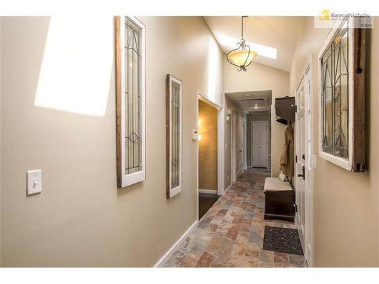 Bright and Cheery Entry with Beautiful Slate Tile and Skylight. (photo 2)