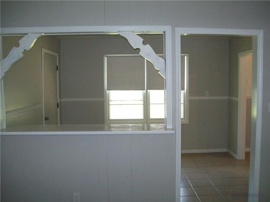 View from Den into Dining Room w/snack bar and tile floors (photo 4)