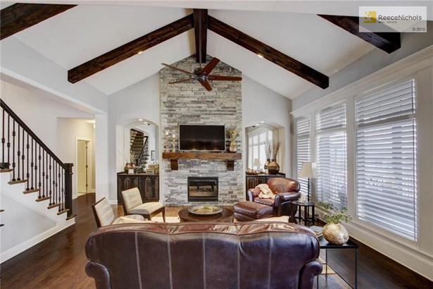 Custom mirrors and built in cabinets frame the stunning fireplace. (photo 5)