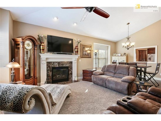 Open floor plan, living room with beautiful fireplace (photo 3)