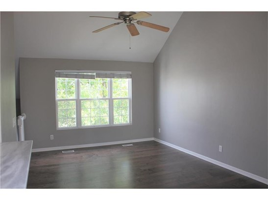 Living room with new hardwood floors and freshly painted walls (photo 3)