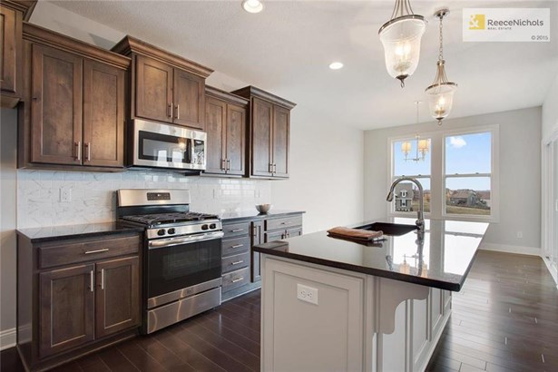 Great Room open to Kitchen- **PHOTOS ARE OF THE QUINTESSA MODEL & NOT ACTUAL HOME** (photo 5)