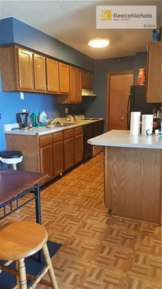 Lots of cabinet space with nice size dining area. (photo 2)