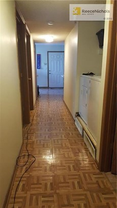 Looking down the hallway - laundry in convenient location. (photo 3)