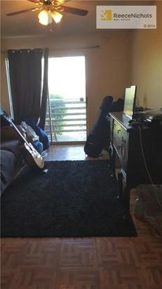 Living room w/door to balcony.  Pergo flooring also in kitchen. (photo 4)