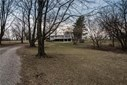 This is the back of the home, and wouldn't it be nice to come home to the sun room overlooking the barn and pastures. (photo 1)
