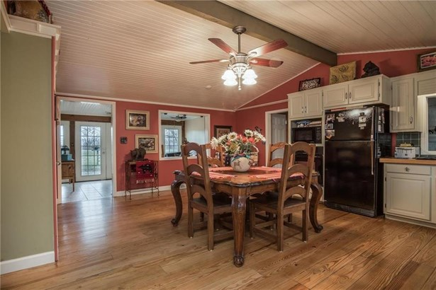 The bright kitchen looks into the family room from the wide doorway and the opening above the stove. (photo 5)